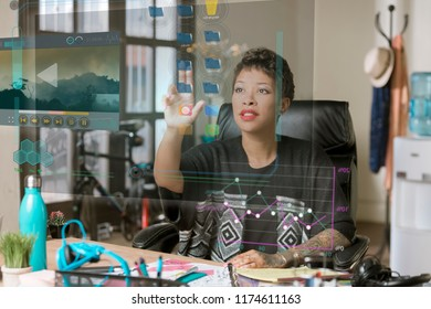 Professional woman working on a futuristic screen in her office