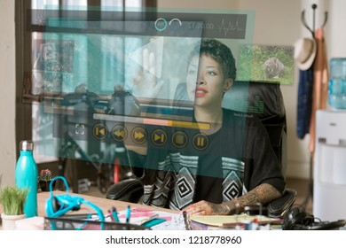 Professional woman working on a futuristic video screen in her office