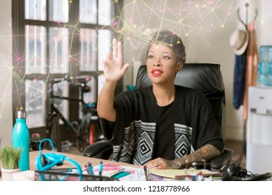 Professional woman working on a futuristic web projection in her office
