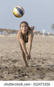 professional wonman beach volleyball player during training
