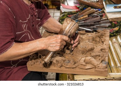 The professional wood carving doing his craft