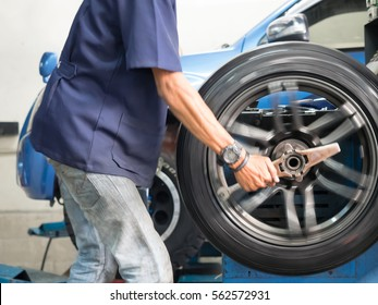 Professional worker are changing tire of car