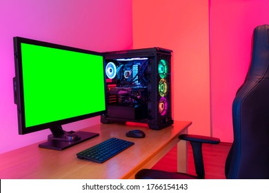 Professional workstation and gaming computer, to play video games online or do professional design and multimedia work. In a room with colorful neon led lights.