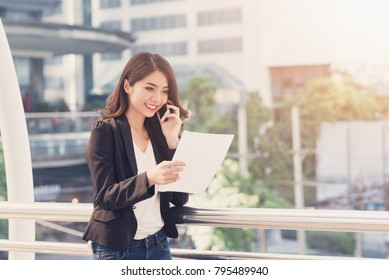 Professional young business woman  reading electronic book on digital tablet for bussiness job at the city in morning. Business woman concept