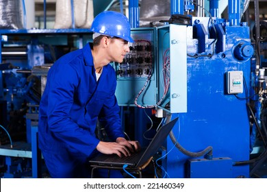 professional young electrician analyzing data on his laptop