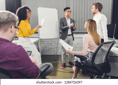 professional young multiethnic business people discussing during meeting in office