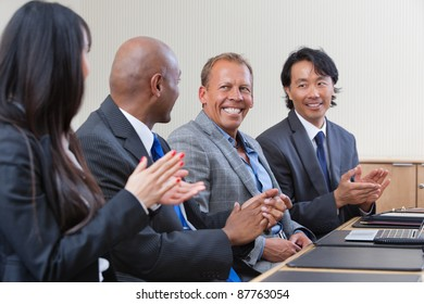 Professionals applauding during a business meeting