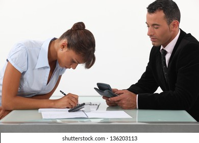 Professionals calculating their budget