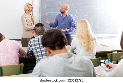 Professionals and happy adult coach at training session for employees
