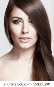 Professionaly retouched studio HD capture. Portrait of a beautiful young brunette woman with long hair