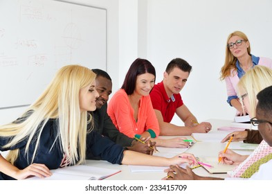 Professor examines a group of young students, black, white, Chinese and girls,