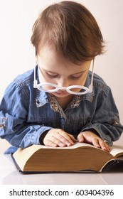 Professor reading a book. (Humorous picture). Science, knowledge, teaching, success, self development concept.