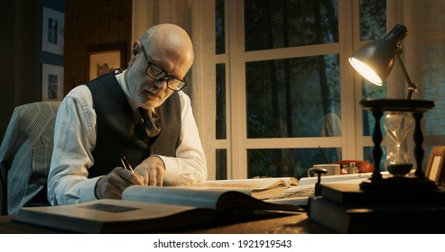 Professor working in his office, he is writing and reading books, research and knowledge concept