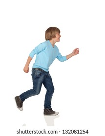 Profile of adorable preteen boy walking isolated on a over white background