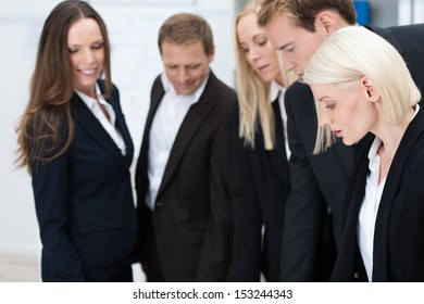 Profile of an attractive blond businesswoman working with her team in the office