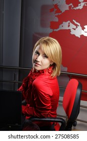 profile of attractive television presenter looking at the camera