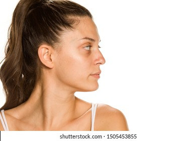 Profile of bautiful young woman without makeup on white background