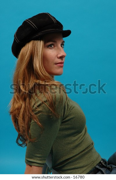 Profile of a beautiful model wearing a black suede hat