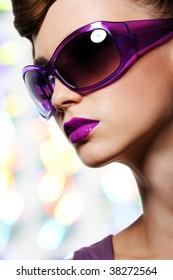 profile of beautiful stylish girl in fashion sunglasses - close-up portrait