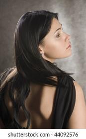 Profile of a beautiful woman in a black dress.