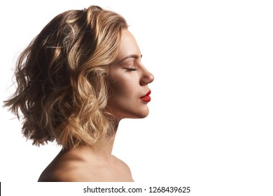 Profile of a beautiful woman with closed eyes, over white background