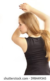profile of the beautiful young girl, portrait from a back. on a white background