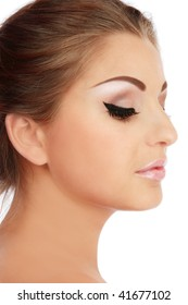 Profile of beautiful young woman with trendy makeup