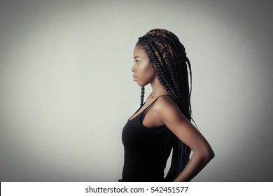 Profile of a black girl in black top