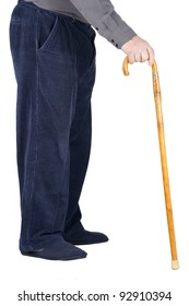 Profile of bottom half of an old man or elderly person walking with a wood cane, wearing blue corduroy and slippers, isolated on white.