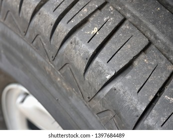 the profile of a car tire in close-up, the structure and the profile can be seen in detail