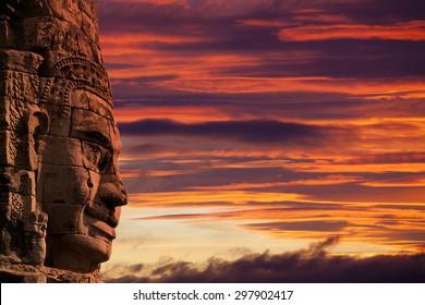 Profile face sculpture of king Jayavarman VII (others believe it's the bodhisattva of compassion called Avalokitesvara or Lokesvara) at The Bayon Temple, Angkor Wat, Combodia