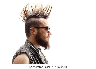 Profile face shot of a male punker with mohawk hairstyle isolated on white background