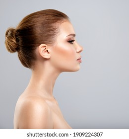 Profile face of  young  woman - isolated. Profile portrait of a  face of the young pretty girl.  Skin care concept.