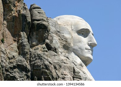 The profile of the first president of the United States, President George Washington, carved into the stone of the Black Hills of South Dakota a by Gutzon Borglum