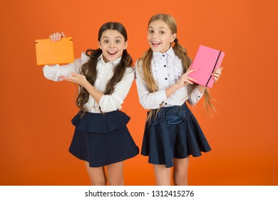 Profile for friends notepad. Dear diary. School stationery. Girls cute kids school uniform orange background. Schoolgirl show book diary or notepad. School supplies concept. We love study in school.