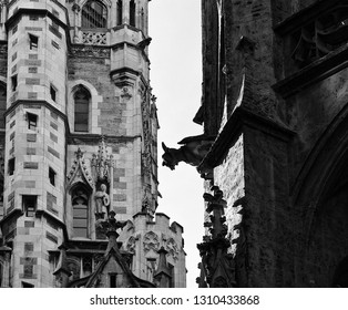 the profile of a gargoyle with devil semblance on the facade of a building in the town hall yard of Munich  in Neo-Gothic style