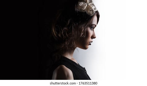 Profile of gorgeous serious young woman face vinous lips evening make up posing on black and white horizontal studio background. Concept of fashion stylish accessories