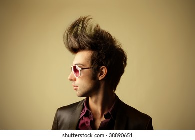 profile of guy with big tuft