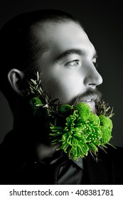 Profile of a handsome man with a beard of green flowers. Men's beauty. Barbershop.