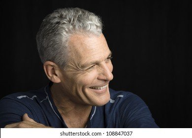 Profile of a handsome man with grey hair