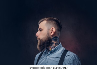 Profile of a handsome old-fashioned hipster in a blue shirt and suspenders.