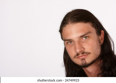 Profile of long hair and bearded young man