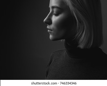 Profile of a lovely blond woman. black and white