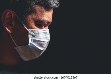 Profile of man in mask, concept of viral infection. Theme of corona-virus epidemic.
