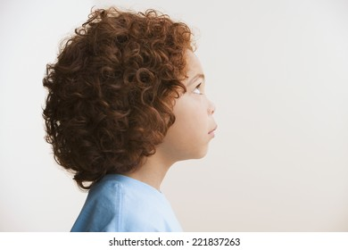 Profile of Mixed Race boy looking up