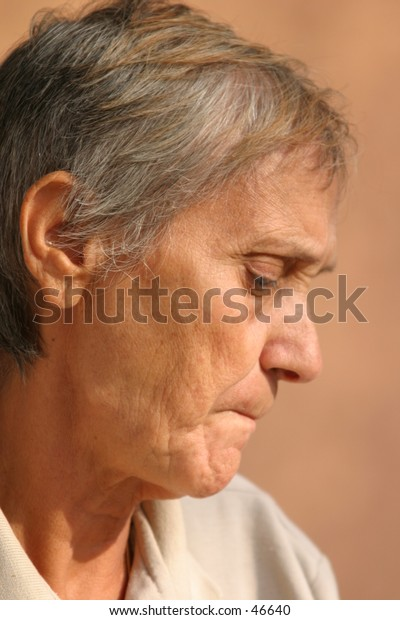 profile of an old woman thinking