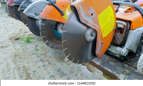 Profile on the blade of an asphalt or concrete cutter and workers boots Profile on Asphalt Cutter Profile