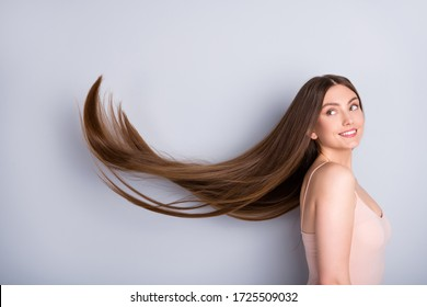 Profile photo of attractive model lady look demonstrate ideal neat long healthy hairstyle flying on air after lamination procedure wear beige singlet isolated grey color background - Shutterstock ID 1725509032