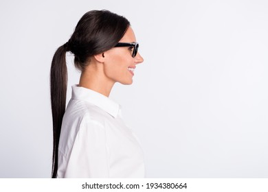 Profile photo of optimistic brunette hairdo lady near empty space wear spectacles white shirt isolated on grey color background