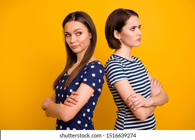 Profile photo of two amazing ladies in bad mood had fight not talk to each other standing back-to-back wear summer casual t-shirts isolated yellow background